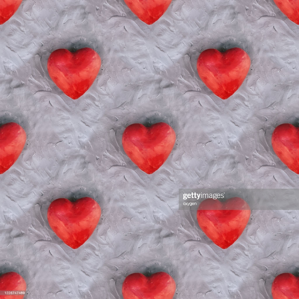 red heart shape seamless pattern on gray plasticine background day picture id