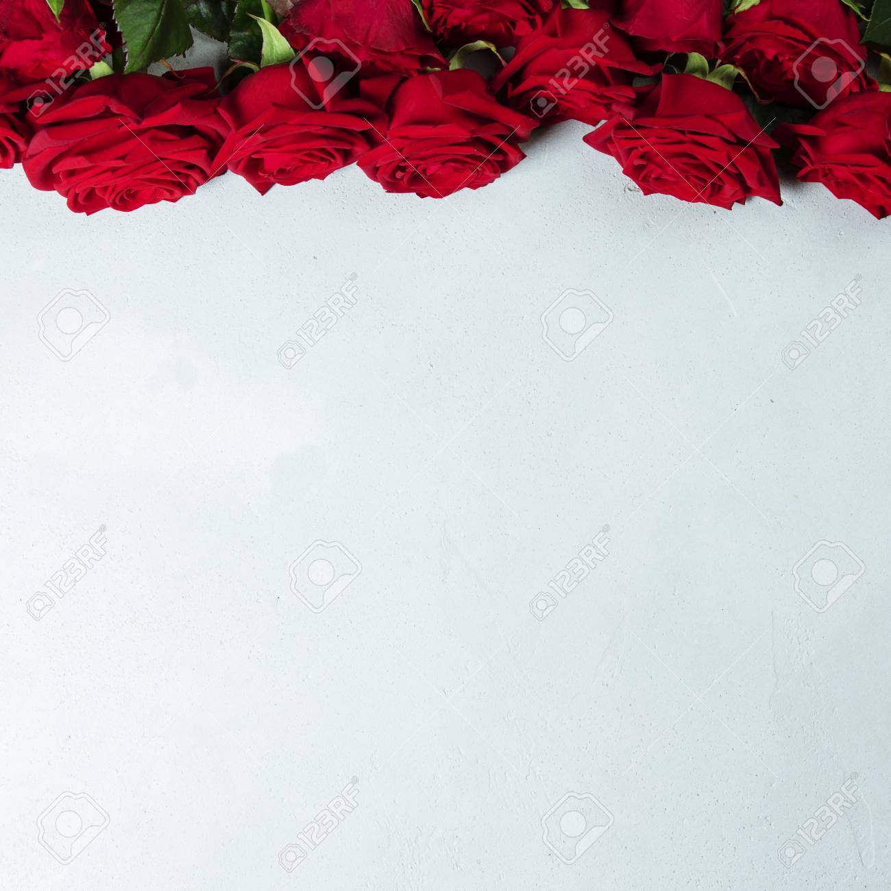photo roses on a white conctere background big beautiful bouquet of red roses a t for a wedding birthda