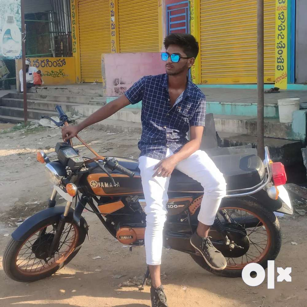rx 100 bike full in condition all parts are new painting newly iid