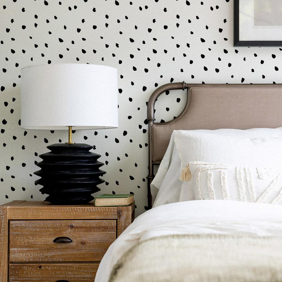 Modern black and white bedroom interior with spotty removable wallpaper 900x