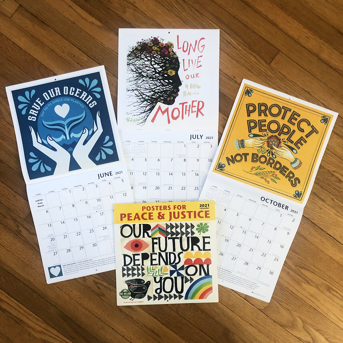 snos art included in 2021 posters for peace and justice calendar