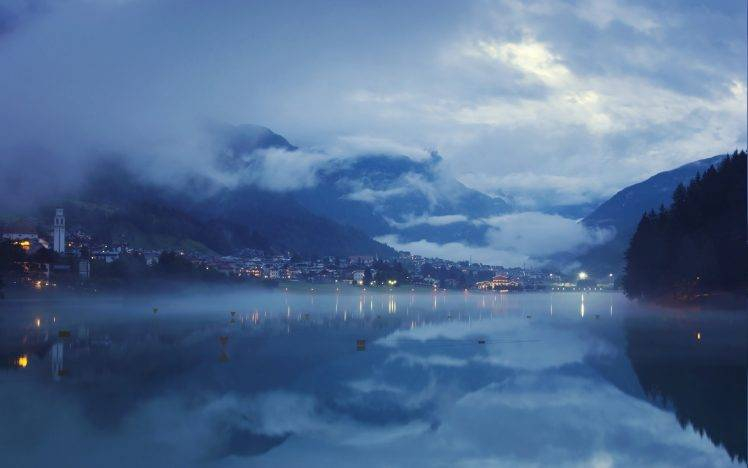 landscape blue lake nature mist clouds mountain city lights water reflection evening calm valley