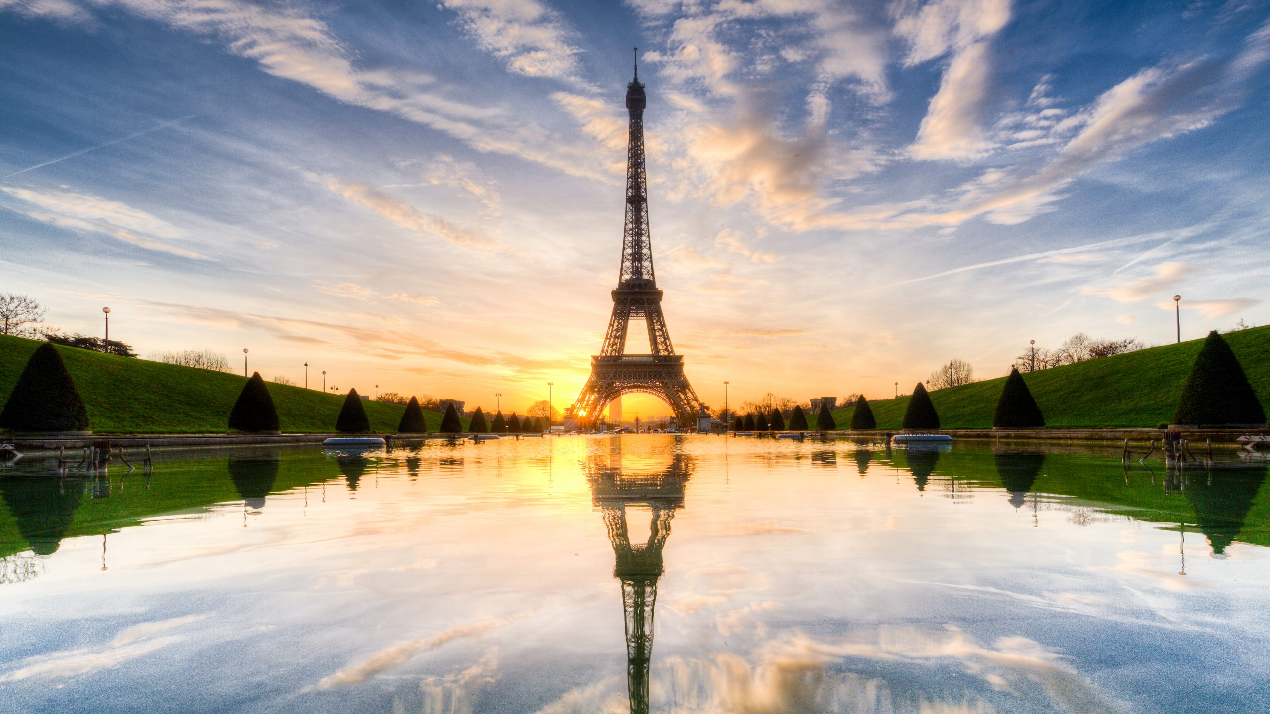 eiffel tower and reflection on water with blue sky and clouds background during sunrise 4k 5k hd travel wallpapers