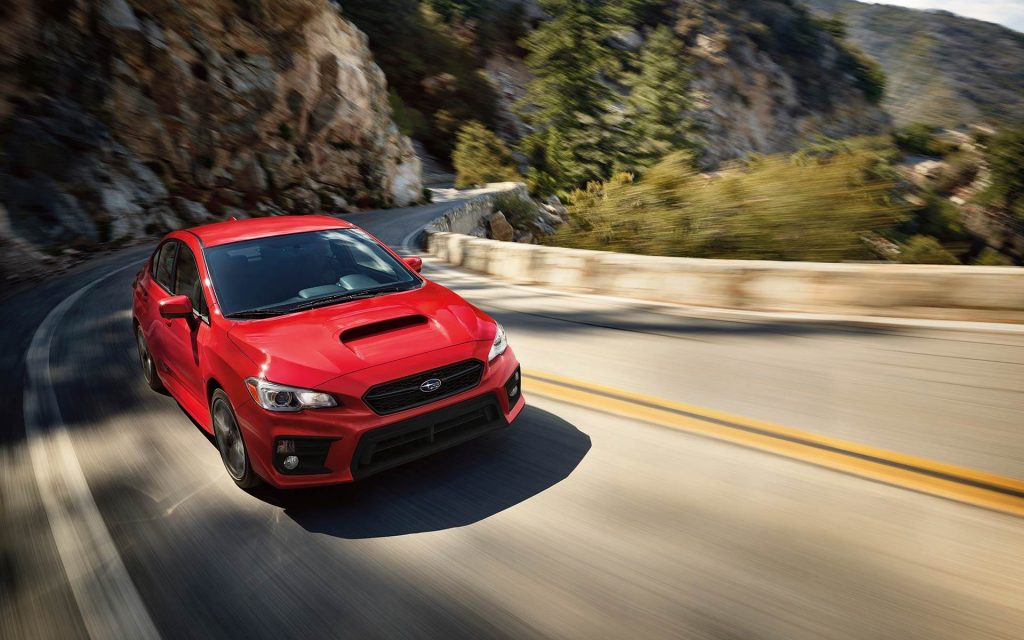 2019 subaru wrx sti red color front view on highway hills background 4k hd wallpaper